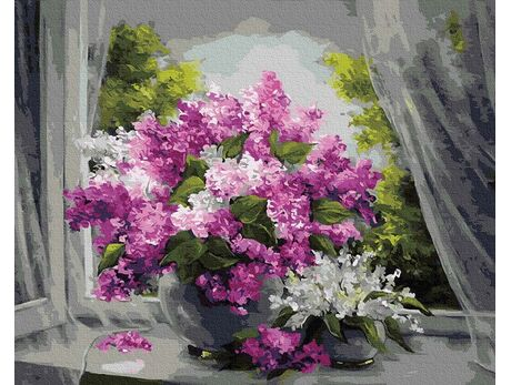 Bouquet of lilacs on the window